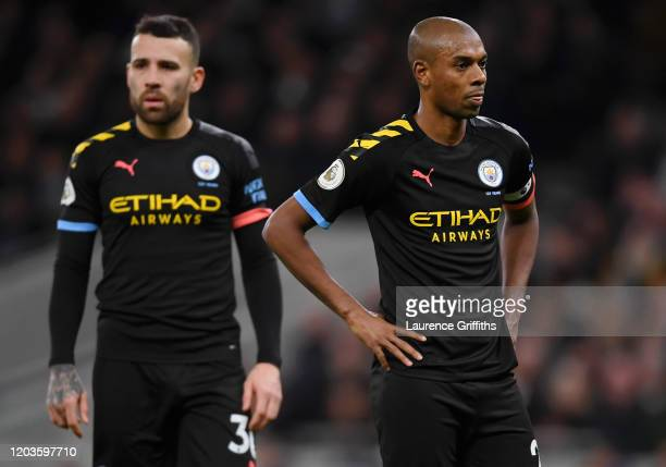 Fernandinho and Nicolas Otamendi of Manchester City show their disappointment during the Premier League match between Tottenham Hotspur and...