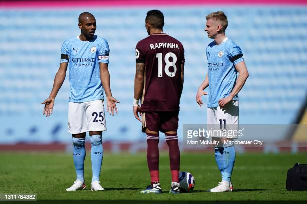 Fernandinho and Oleksandr Zinchenko of Manchester City talk to Raphinha of Leeds United during the Premier League match between Manchester City and...
