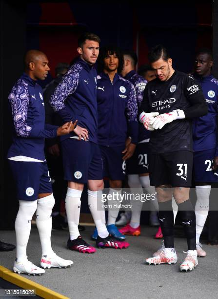 Fernandinho, Aymeric Laporte, Nathan Ake and Ederson of Manchester City speak in the tunnel prior to the Premier League match between Crystal Palace...