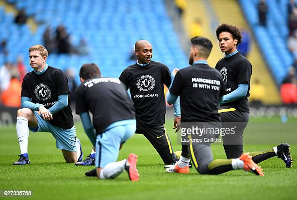 Fernandinho Kevin De Bruyne Leroy Sane and Manchester City players wearing tshirts to commemorate the victims of the plane crash involving the...