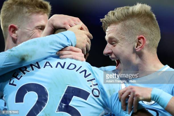 Fernandinho Luiz Roza of Manchester City celebrates after scoring a goal to make it 10 with Aleksandr Zinchenko of Manchester City during the Premier...