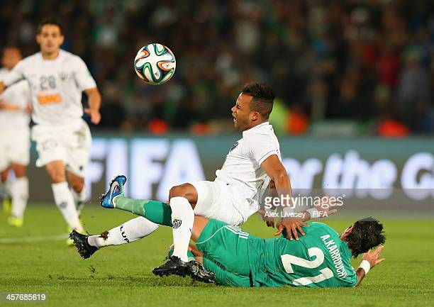 Fernandinho of Atletico Mineiro is tackled by Adil Karrouchy of Raja Casablanca during the FIFA Club World Cup Semi Final match between Raja...