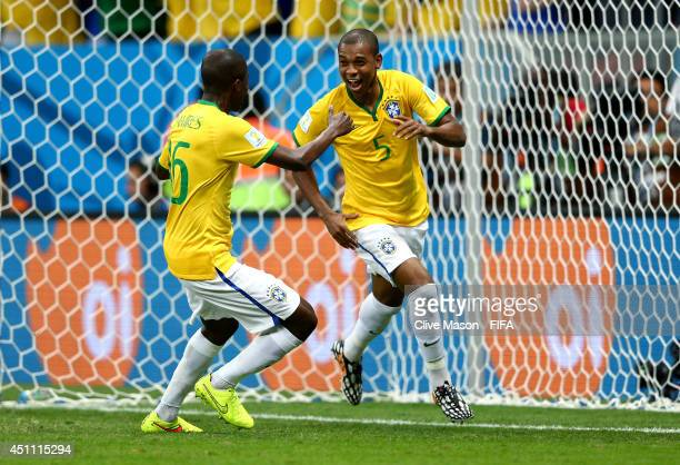 Fernandinho of Brazil celebrates scoring his team's fourth goal with his teammate Ramires during the 2014 FIFA World Cup Brazil Group A match between...