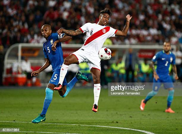 Fernandinho of Brazil fights for the ball with Andy Polo of Peru during a match between Peru and Brazil as part of FIFA 2018 World Cup Qualifiers at...