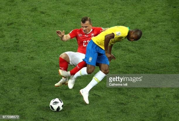 Fernandinho of Brazil is tackled by Xherdan Shaqiri of Switzerland during the 2018 FIFA World Cup Russia group E match between Brazil and Switzerland...