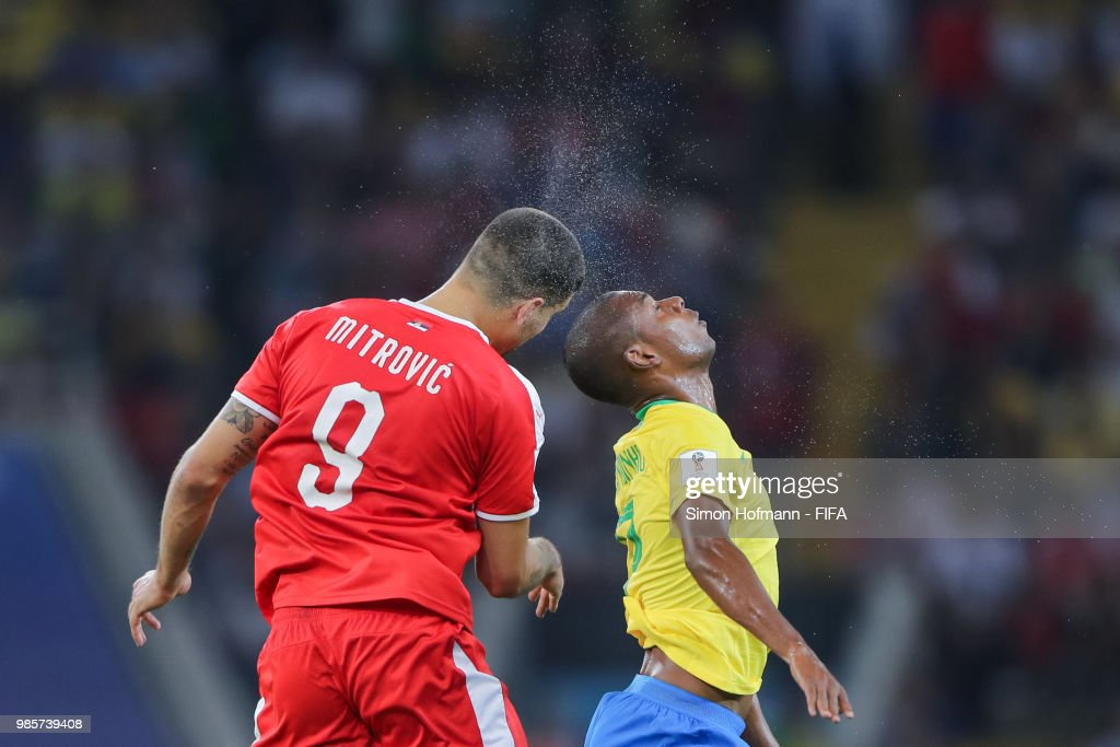 Fernandinho of Brazil jumps for a header with Aleksandar Mitrovic of Serbia during the 2018 FIFA World Cup Russia group E match between Serbia and Brazil at Spartak Stadium on June 27, 2018 in Moscow, Russia.