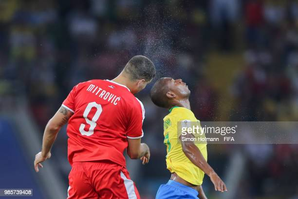 Fernandinho of Brazil jumps for a header with Aleksandar Mitrovic of Serbia during the 2018 FIFA World Cup Russia group E match between Serbia and...