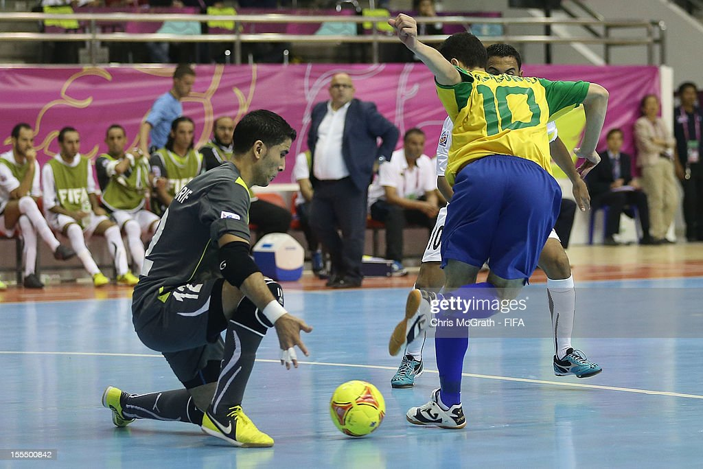 Fernandinho #10 of Brazil kicks a goal against Libya during the FIFA Futsal World Cup, Group C match between Brazil and Libya at Korat Chatchai Hall on November 4, 2012 in Nakhon Ratchasima, Thailand.