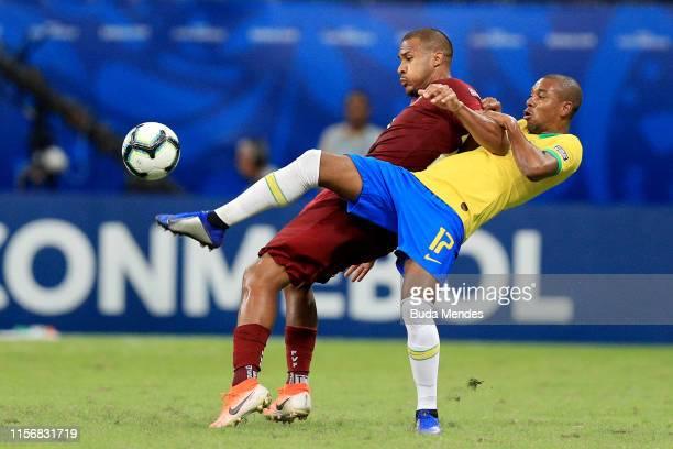 Fernandinho of Brazil kicks the ball against Salomon Rondon of Venezuela during the Copa America Brazil 2019 group A match between Brazil and...
