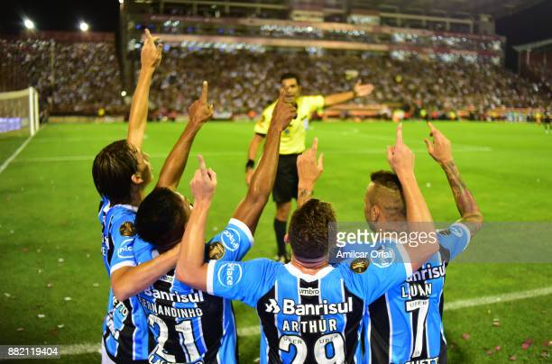 Fernandinho of Gremio and teammates celebrate the opening goal during the second leg match between Lanus and Gremio as part of Copa Bridgestone...