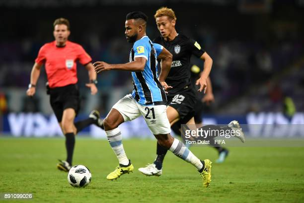 Fernandinho of Gremio FBPA and Keisuke Honda of CF Pachuca battle for the ball during the FIFA Club World Cup UAE 2017 match between Gremio FBPA and...