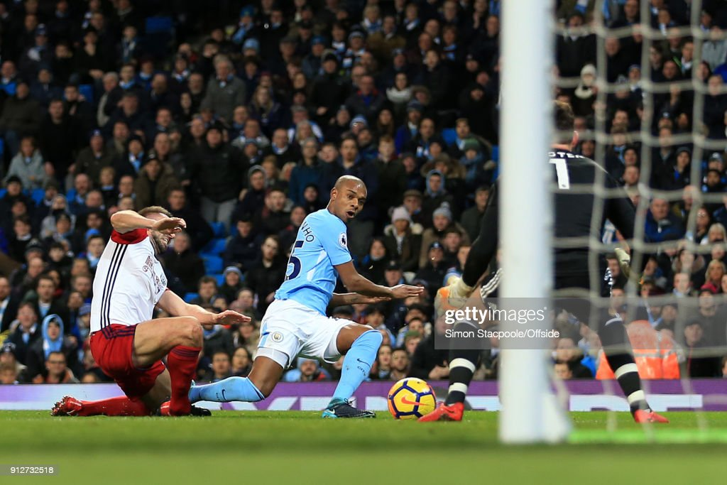 Fernandinho of Man City scores their 1st goal during the Premier League match between Manchester City and West Bromwich Albion at the Etihad Stadium on January 31, 2018 in Manchester, England.