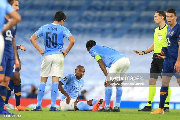 Fernandinho of Man City sits on the ground clutching his thigh before being taken off with an injury during the UEFA Champions League Group C match...