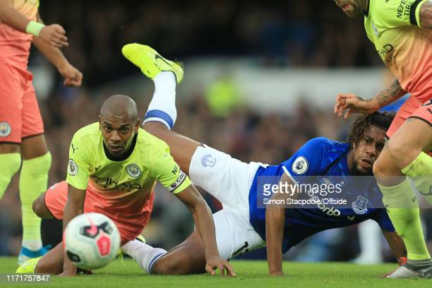 Fernandinho of Man City tackles Alex Iwobi of Everton during the Premier League match between Everton FC and Manchester City at Goodison Park on...