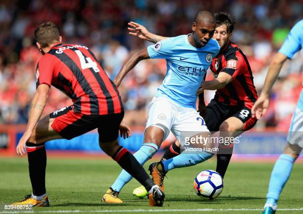 Fernandinho of Manchester City and Harry Arter of AFC Bournemouth battle for possession during the Premier League match between AFC Bournemouth and...