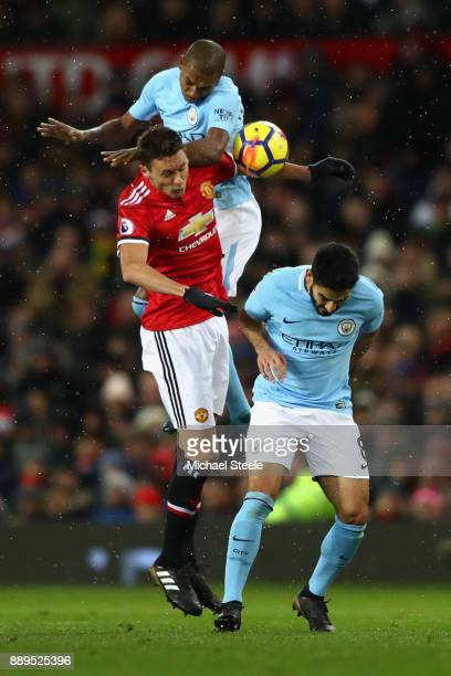 Fernandinho of Manchester City and Ilkay Gundogan of Manchester City clash with Nemanja Matic of Manchester United during the Premier League match...