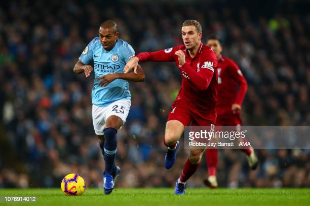 Fernandinho of Manchester City and Jordan Henderson of Liverpool during the Premier League match between Manchester City and Liverpool FC at Etihad...