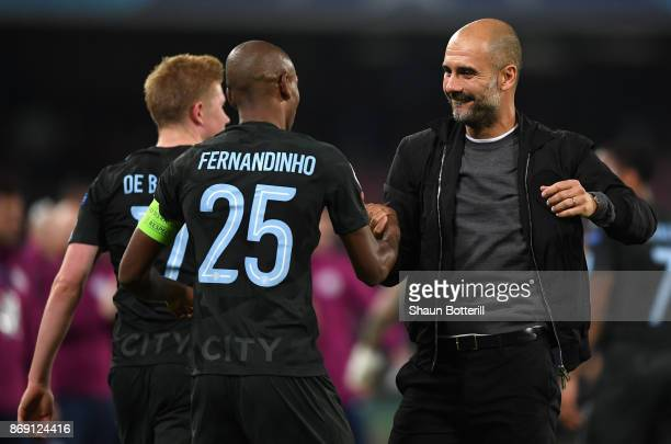 Fernandinho of Manchester City and Josep Guardiola Manager of Manchester City embrace after the UEFA Champions League group F match between SSC...