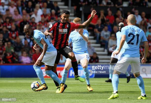 Fernandinho of Manchester City and Joshua King of AFC Bournemouth battle for possession during the Premier League match between AFC Bournemouth and...