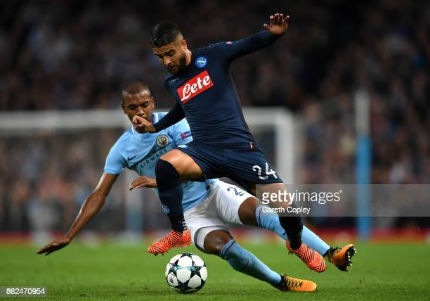 Fernandinho of Manchester City and Lorenzo Insigne of SSC Napoli battle for possession during the UEFA Champions League group F match between...