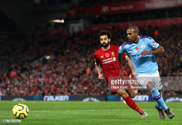 Fernandinho of Manchester City and Mohamed Salah of Liverpool in action during the Premier League match between Liverpool FC and Manchester City at...