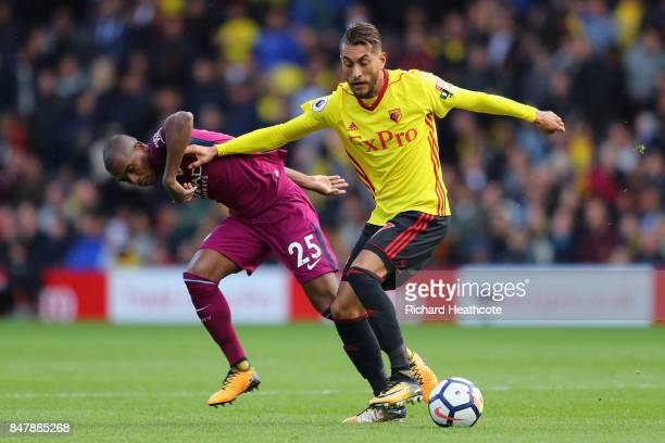 Fernandinho of Manchester City and Roberto Pereyra of Watford battle for possession during the Premier League match between Watford and Manchester...