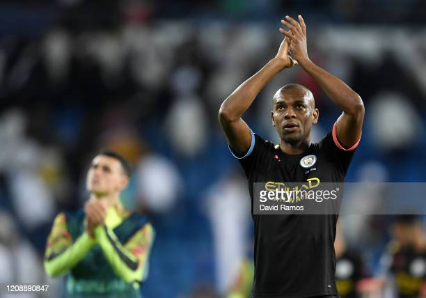 Fernandinho of Manchester City applauds fans after the UEFA Champions League round of 16 first leg match between Real Madrid and Manchester City at...