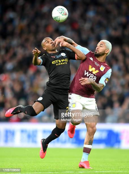 Fernandinho of Manchester City battles for possession with Douglas Luiz of Aston Villa during the Carabao Cup Final between Aston Villa and...
