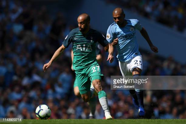 Fernandinho of Manchester City battles for possession with Lucas Moura of Tottenham Hotspur during the Premier League match between Manchester City...