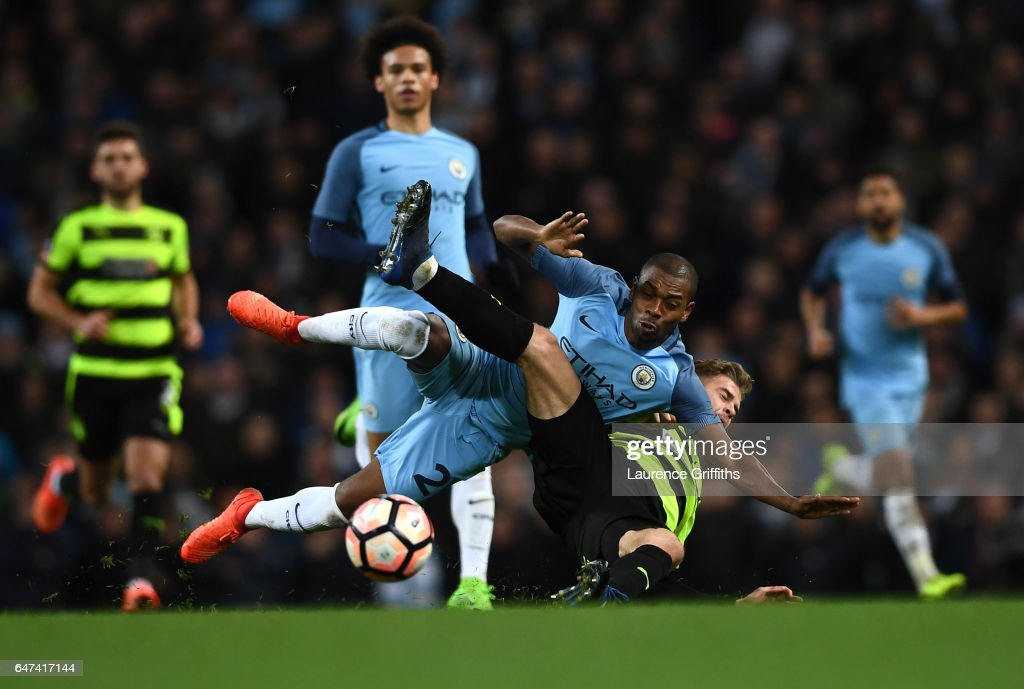 Fernandinho of Manchester City battles with Martin Cranie of Huddersfield Town during the Emirates FA Cup Fifth Round Replay match between Manchester City and Huddersfield Town at Etihad Stadium on March 1, 2017 in Manchester, England.