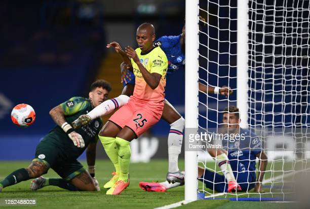 Fernandinho of Manchester City blocks the ball with his hand resulting in a red card during the Premier League match between Chelsea FC and...