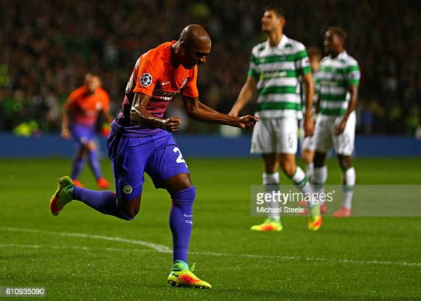 Fernandinho of Manchester City ceclebrates after scoring his team's first goal during the UEFA Champions League group C match between Celtic FC and...