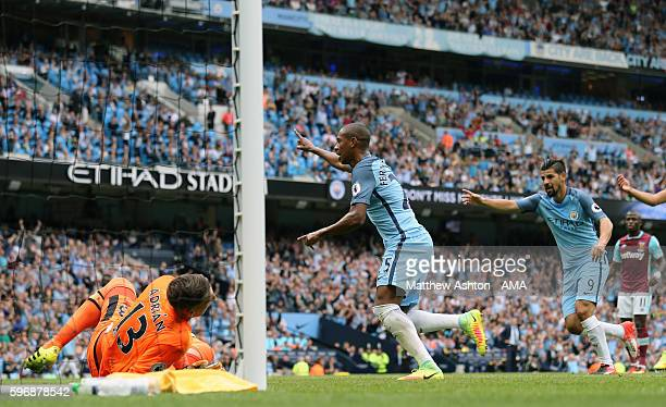 Fernandinho of Manchester City celebrates after scoring a goal to make it 20 during the Premier League match between Manchester City and West Ham...