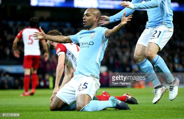 Fernandinho of Manchester City celebrates after scoring his sides first goal during the Premier League match between Manchester City and West...