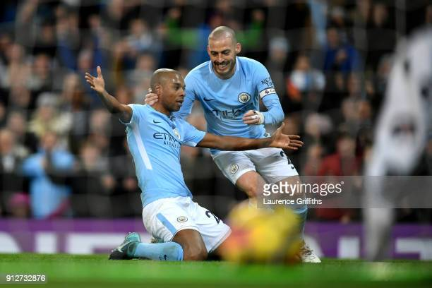 Fernandinho of Manchester City celebrates after scoring his sides first goal with David Silva of Manchester City during the Premier League match...