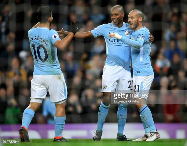 Fernandinho of Manchester City celebrates after scoring his sides first goal with Sergio Aguero of Manchester City and David Silva of Manchester City...