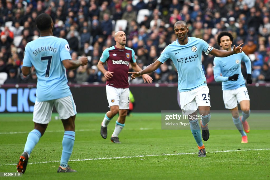 Fernandinho of Manchester City celebrates after scoring his sides fourth goal with Raheem Sterling of Manchester City during the Premier League match between West Ham United and Manchester City at London Stadium on April 29, 2018 in London, England.