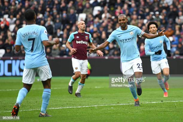 Fernandinho of Manchester City celebrates after scoring his sides fourth goal with Raheem Sterling of Manchester City during the Premier League match...