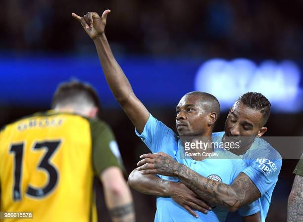 Fernandinho of Manchester City celebrates after scoring his sides third goal with Danilo of Manchester City during the Premier League match between...