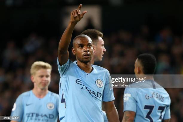 Fernandinho of Manchester City celebrates after scoring his sides third goal during the Premier League match between Manchester City and Brighton and...