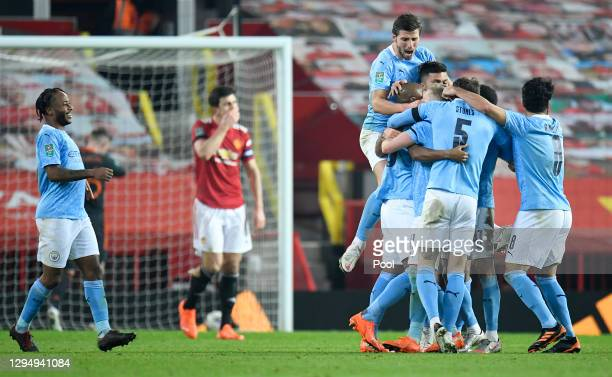 Fernandinho of Manchester City celebrates after scoring his teams second goal with his team mates during the Carabao Cup Semi Final match between...