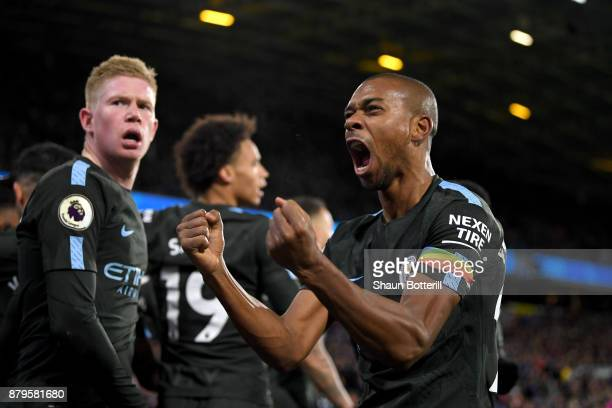 Fernandinho of Manchester City celebrates as Raheem Sterling of Manchester City celebrates scoring the 2nd Manchester City goal during the Premier...