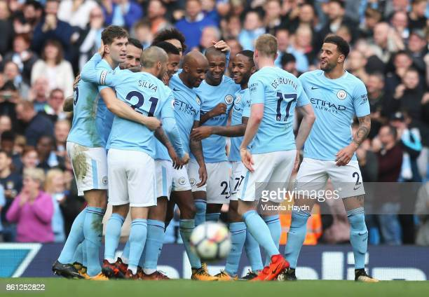 Fernandinho of Manchester City celebrates scoring his sides fifth goal with his Manchester City team mates during the Premier League match between...