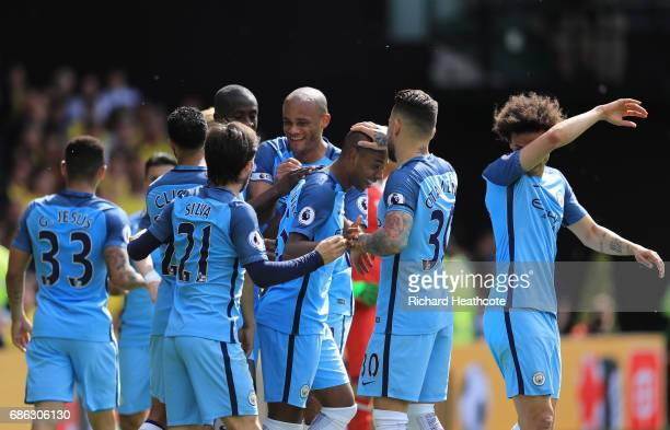 Fernandinho of Manchester City celebrates scoring his sides fourth goal with his Manchester City team mates during the Premier League match between...