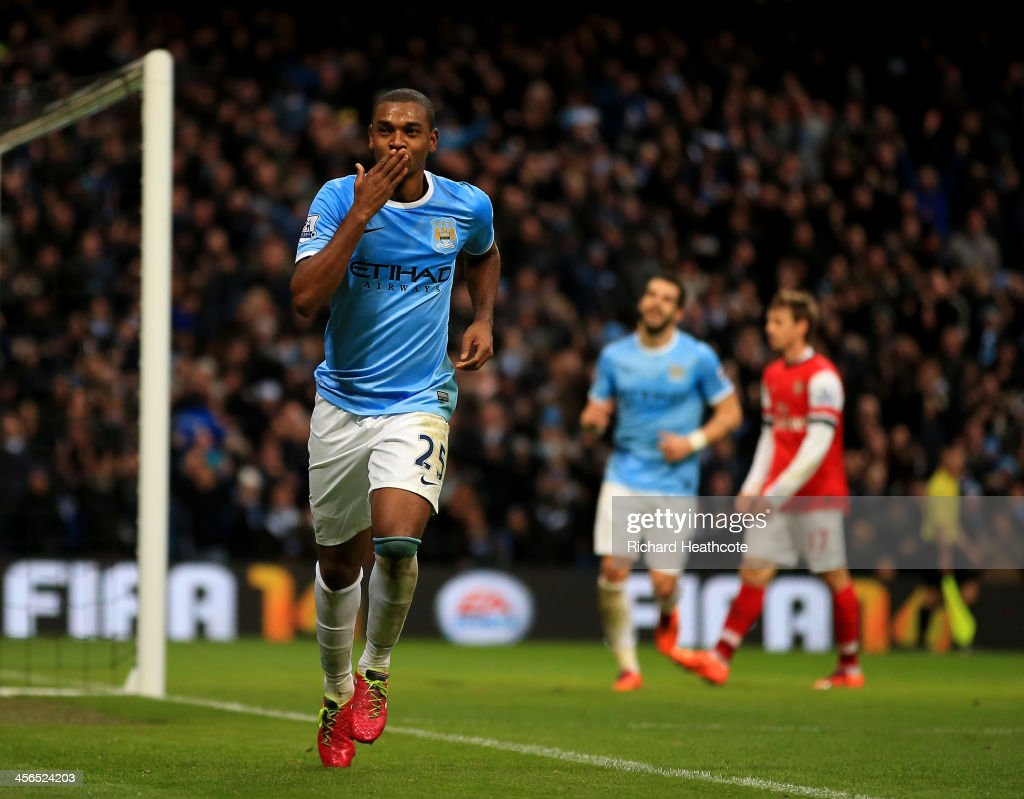 Fernandinho of Manchester City celebrates scoring their fifth goal during the Barclays Premier League match between Manchester City and Arsenal at Etihad Stadium on December 14, 2013 in Manchester, England.