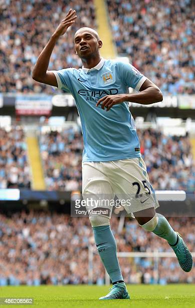 Fernandinho of Manchester City celebrates scoring their second goal during the Barclays Premier League match between Manchester City and Watford at...