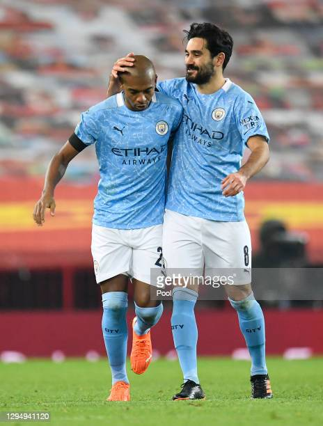 Fernandinho of Manchester City celebrates with Ilkay Guendogan of Manchester City after he scores his sides second goal during the Carabao Cup Semi...