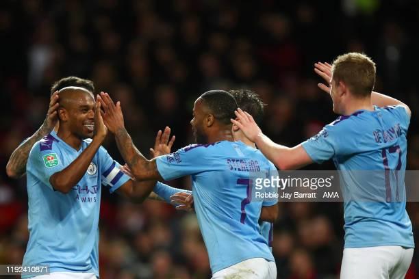 Fernandinho of Manchester City celebrates with Raheem Sterling and Kevin De Bruyne of Manchester City after Andreas Pereira of Manchester United...