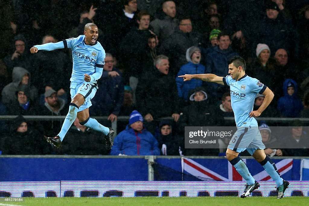 Fernandinho (C) of Manchester City celebrates with teammate Sergio Aguero (R) after scoring the opening goal during the Barclays Premier League match between Everton and Manchester City at Goodison Park on January 10, 2015 in Liverpool, England.