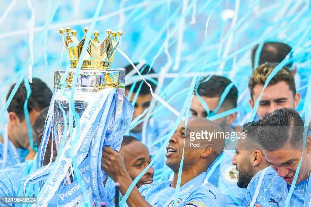 Fernandinho of Manchester City celebrates with the Premier League Trophy as Manchester City are presented with the Trophy as they win the league...